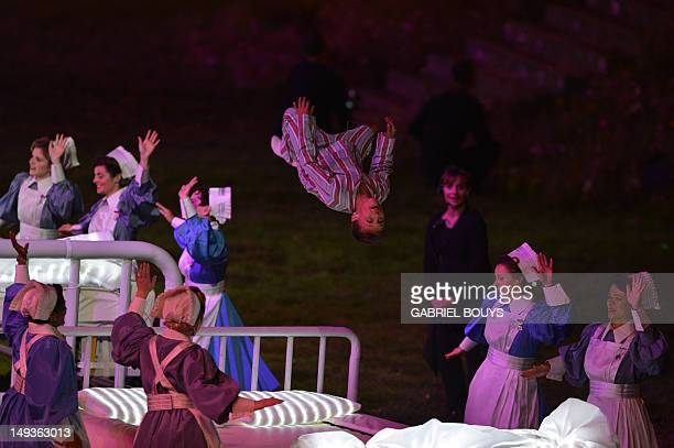Child somersaults as he jumps on a hospital bed during the Great Ormond Street Hospital scene in the opening ceremony of the London 2012 Olympic...