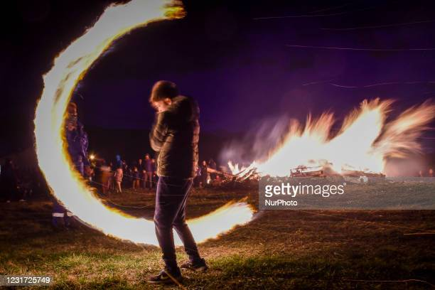 Child spinning fireball near a bonfire during the celebration of 'Sirni Zagovezni', a popular Orthodox Christian holiday which takes place seven...