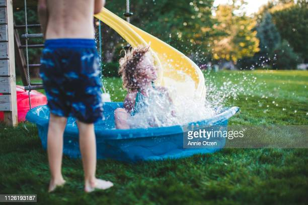 child splashing into a kiddie pool - annie sprinkle stock pictures, royalty-free photos & images