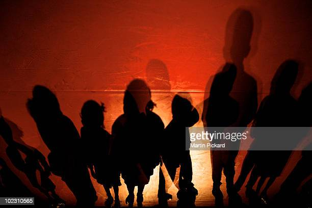 Child spotlit theatrical stage shadows