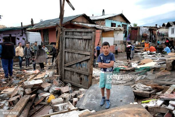A child standing among the debris after homes were razed in a Roma quarter of Sofia At least 20 homes deemed illegal were destroyed by the local...