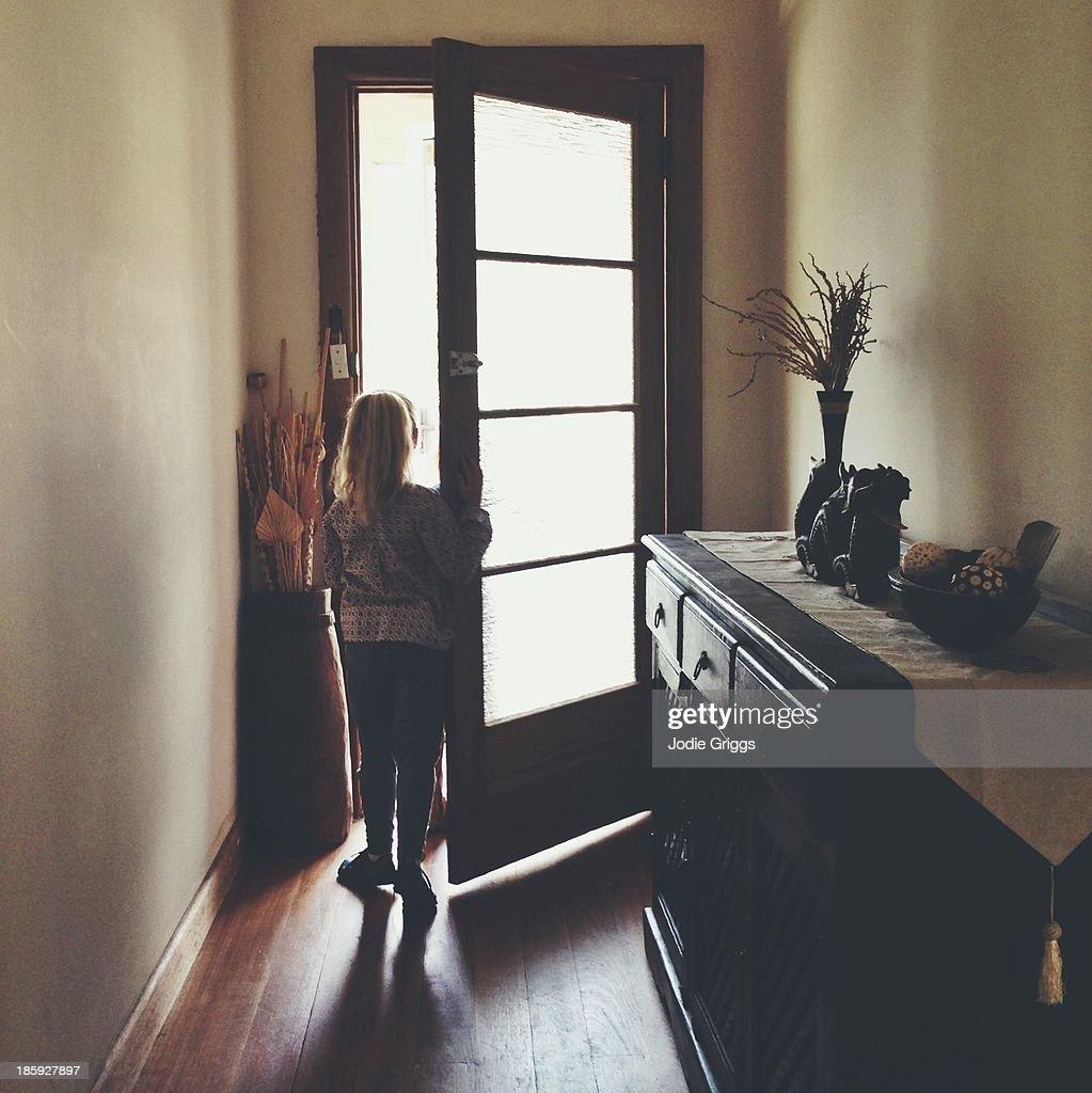 open house door. Child Standing At Open Front Door Of House : Stock Photo T