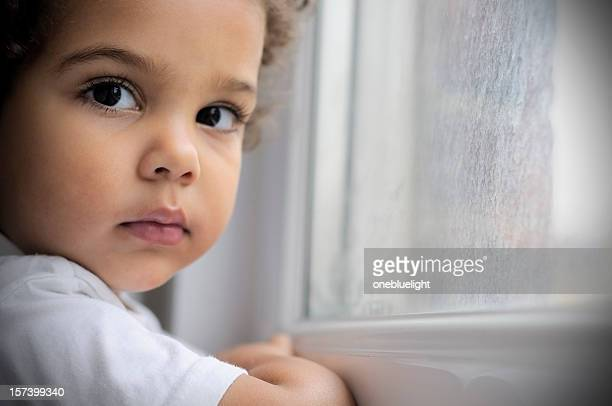 Child (2-3) Standing By the Window