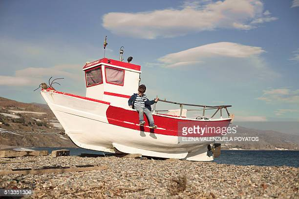 child standing on a boat waterfront