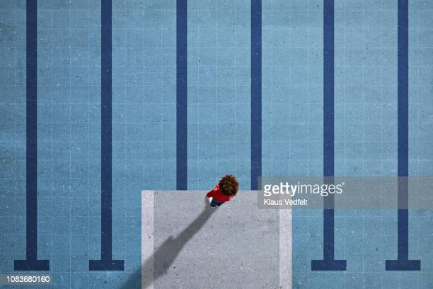 Child standing on painted imaginary pool & diving platform