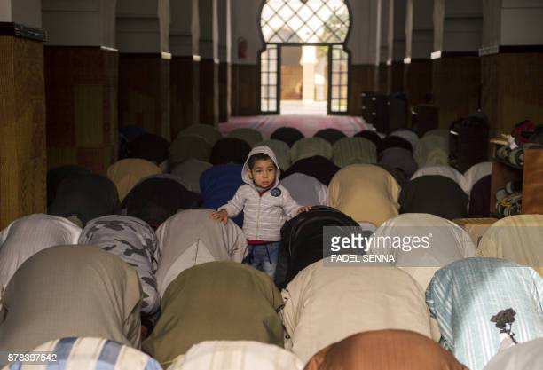 A child stands as Moroccans pray for rain on November 24 2017 in the great mosque of Sale near the capital of Rabat Parched Morocco which is heavily...