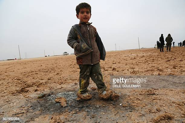 A child stands at a new refugee camp set up for Iraqis mostly fleeing the northern city of Mosul now held by the Islamic State group on the outskirts...