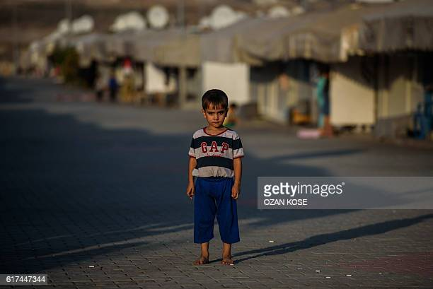 A child stands at a refugee camp in the Kilis district of Gaziantep southeastern Turkey on October 23 2016 France's foreign minister urged the...