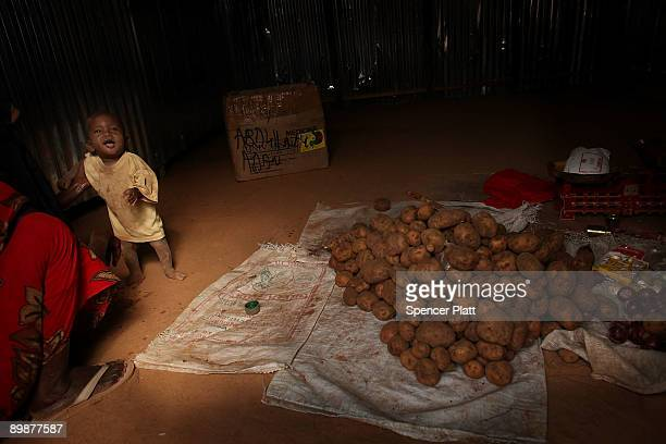 Child stands at the entrance to a food shop in Dadaab, the world�s biggest refugee camp August 19, 2009 in Dadaab, Kenya. The Dadaab refugee complex...