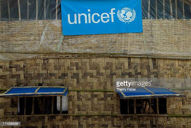 A child stands behind a window in a temporary school set by UNICEF in a village damaged by cyclone Nargis According to official figures the cyclone...
