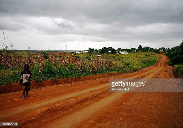 A child stands in a road next to a corn field near to the Kumbali Lodge where Madonna is staying during her attempts to adopt the child Mercy James...