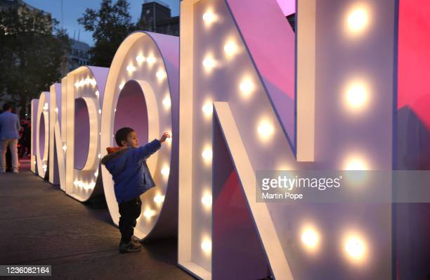 Child stands near an illuminated sign spelling out London during Diwali celebrations in Trafalgar Square on October 23, 2021 in London, England. Many...