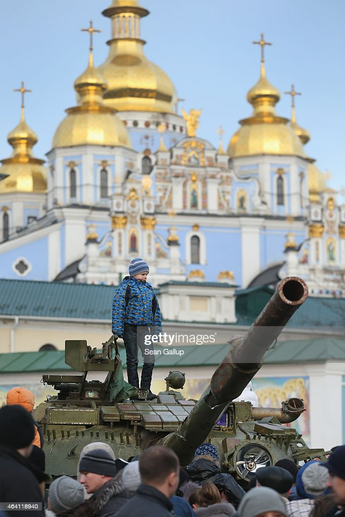 A child stands on top of a heavy tank that is part of an exhibition of weapons, drones, documents and other materials the Ukrainian government claims it recovered in eastern Ukraine and prove direct Russian involvement in the fighting between Ukrainian troops and pro-Russian separatists as St. Michael's golden-domed monastery stands behind on February 22, 2015 in Kiev, Ukraine. Russia has denied sending heavy weaponry to the separatists, admitting only that Russian volunteers are participating in the fighting.