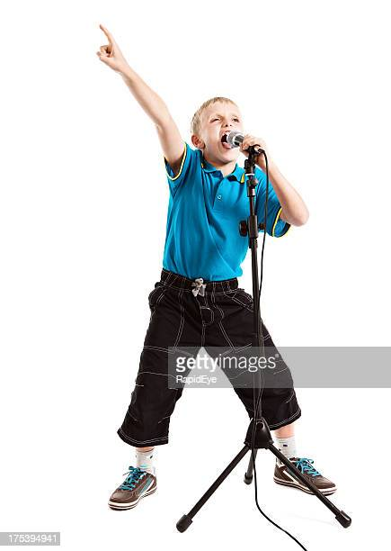 Child star or wannabe pop singer singing enthusiastically into mic
