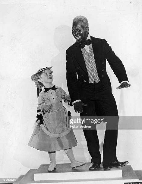 Child star Shirley Temple dancing with Bill 'Bojangels' Robinson in a promotional picture for 'The LIttle Colonel'