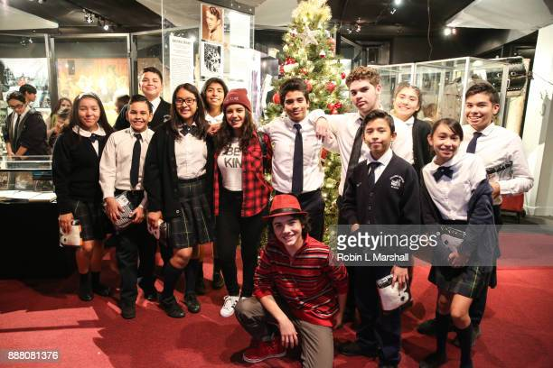 Child Stars Amber Romero and Hunter Payton pose with Dolores Mission School students at the Holiday Tour of the Hollywood Museum at The Hollywood...