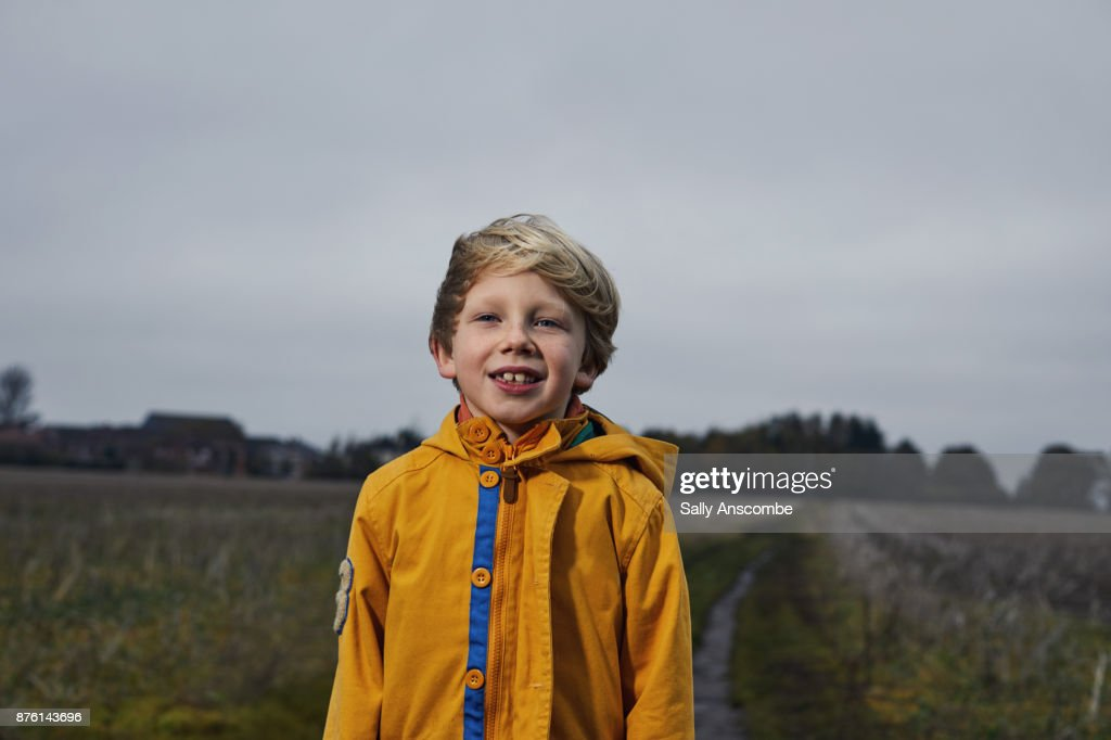 Child stood in a field : Stock Photo