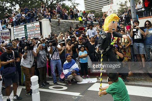 A child strikes a pinata in the likeness of US Presidentelect Donald Trump during a protest in Los Angeles California on Saturday Nov 12 2016 More...