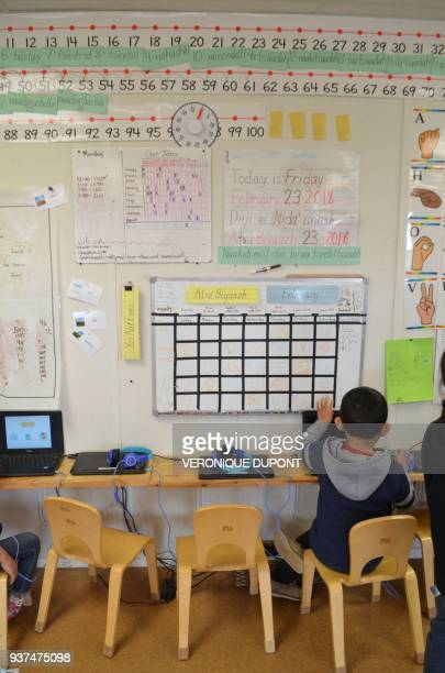 A child studies at the Star School a charter educational facility that wants to revitalize the Navajo language and culture on February 23 2018 in...