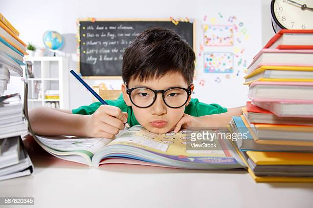 Child studying in classroom