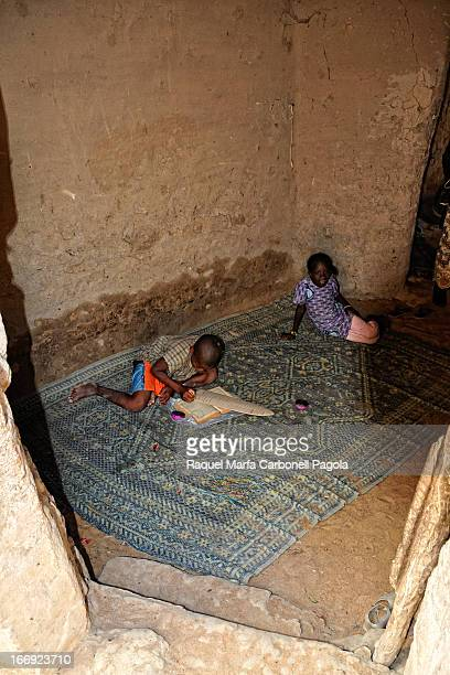 CONTENT] Child studying the Koran inside his home Djenne Mali 2009