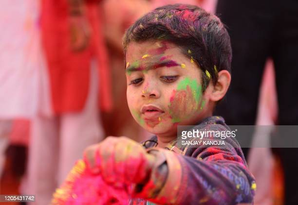A child suffering from cerebral palsy celebrates Holi the spring festival of colours during an event origanized by Trishla Foundation a nonprofit...
