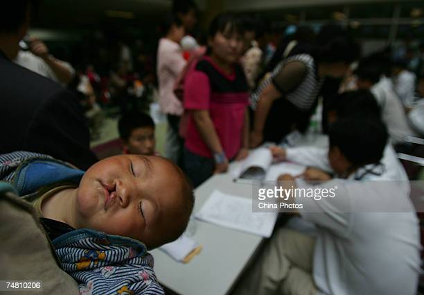 A child suffering from cleft lip and palate is seen at the Xian Jingxi Hospital during registration for treatment jointly administered by Jingxi...