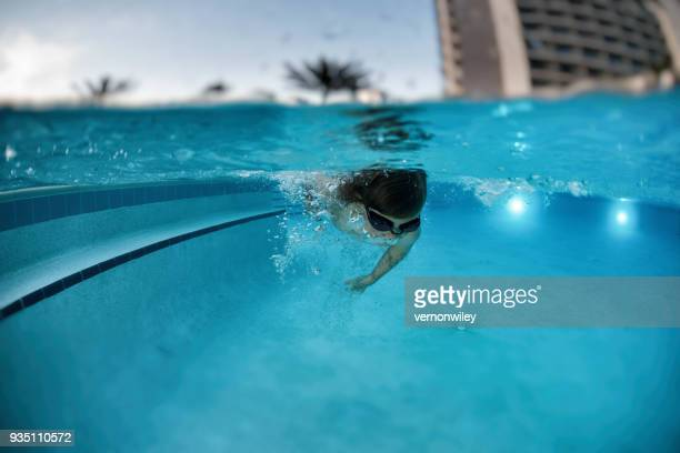 Child swimming in a resort pool
