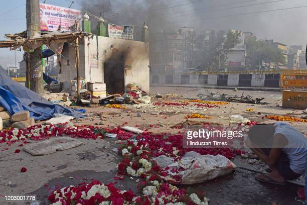 Child takes cover during violent clashes between anti and pro CAA demonstrations at Bhajanpura on February 24, 2020 in New Delhi, India. A Delhi...