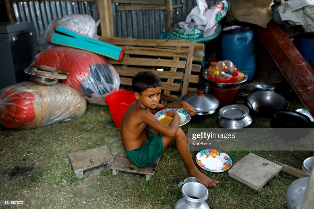 A child takes food in a shelter at Jamtola, Bogra, Bangladesh 17 August 2017. According to authorities, floods caused by heavy rainfall lashing Bangladesh during the past week have left at least 56 people dead. Affected people are waiting to get more relief as they are in shortage of food and drinking water in the shelter centers.