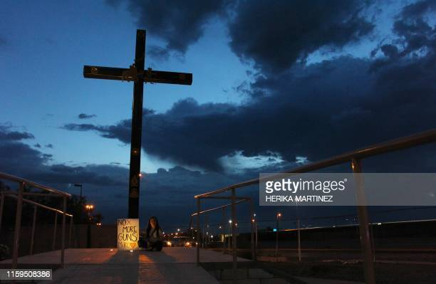 TOPSHOT A child takes part in a vigil in Ciudad Juarez Chihuahua state on August 03 after a mass shooting which left 20 people dead on in El Paso...