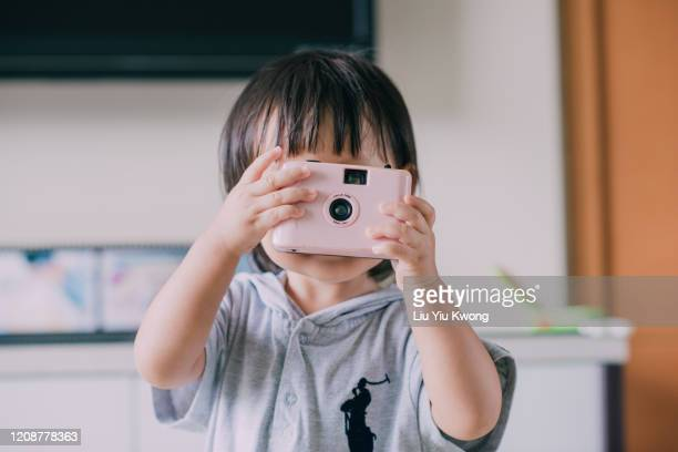 child taking photos as photographer - liu he stock pictures, royalty-free photos & images