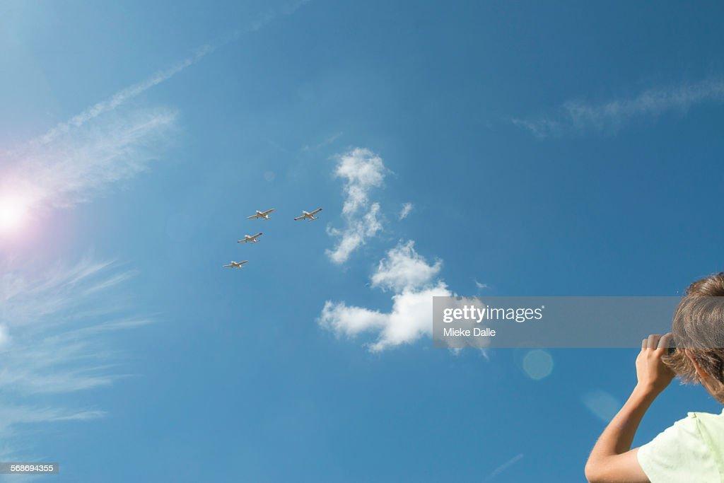 Child taking photos of airplanes : Stock Photo