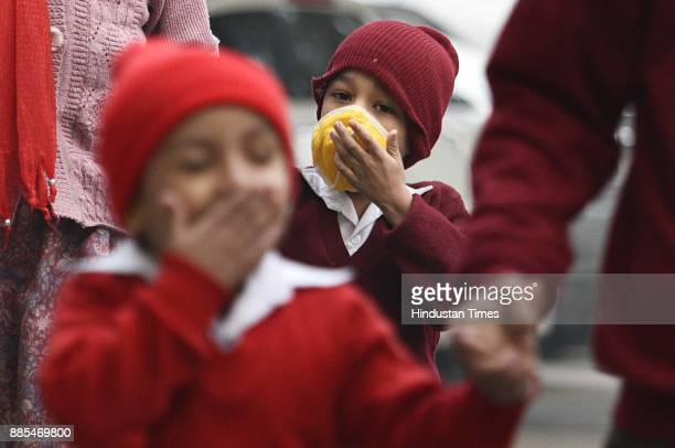 A child taking precautions against cold weather and smog at Green Park on December 4 2017 in New Delhi India Air quality remained very poor with air...