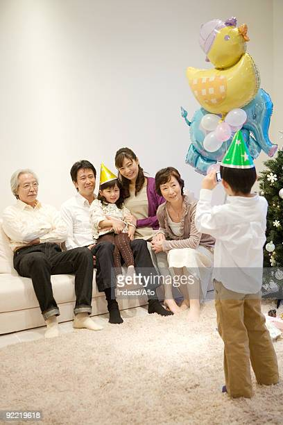 child taking snap of his family - asian granny pics stock photos and pictures