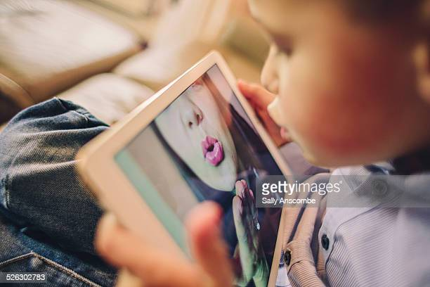 child talking to his mummy over the internet. - kissing stock pictures, royalty-free photos & images