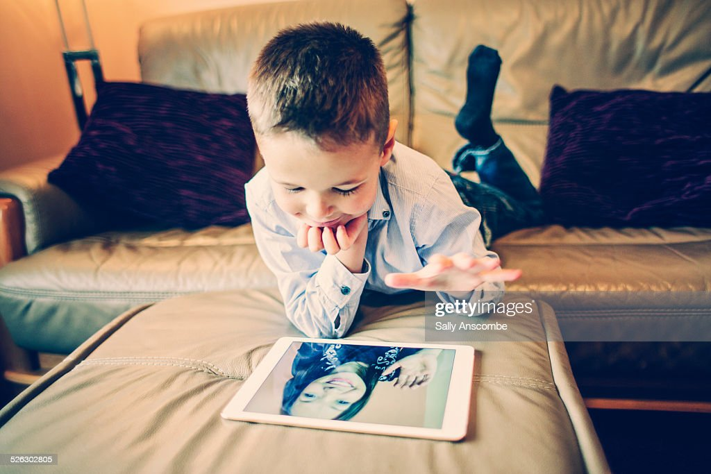 Child talking to his Mummy over the internet. : Stock Photo