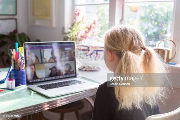 a child talks to her classmates on video conference call - 教育 ストックフォトと画像