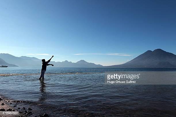 CONTENT] PANAJACHEL SOLOLA GUATEMALA NOVEMBER 12 A child throws his line into Lake Atitlan to catch something to eat Panajachel in the Guatemalan...