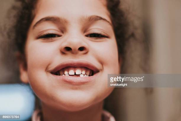 child (5-6) toothy smile - onebluelight stock pictures, royalty-free photos & images