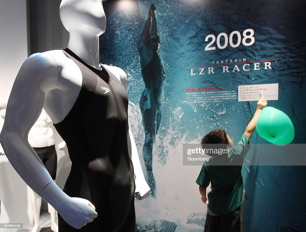 A child touches an advertisement for Speedo's LZR Racer swim : News Photo