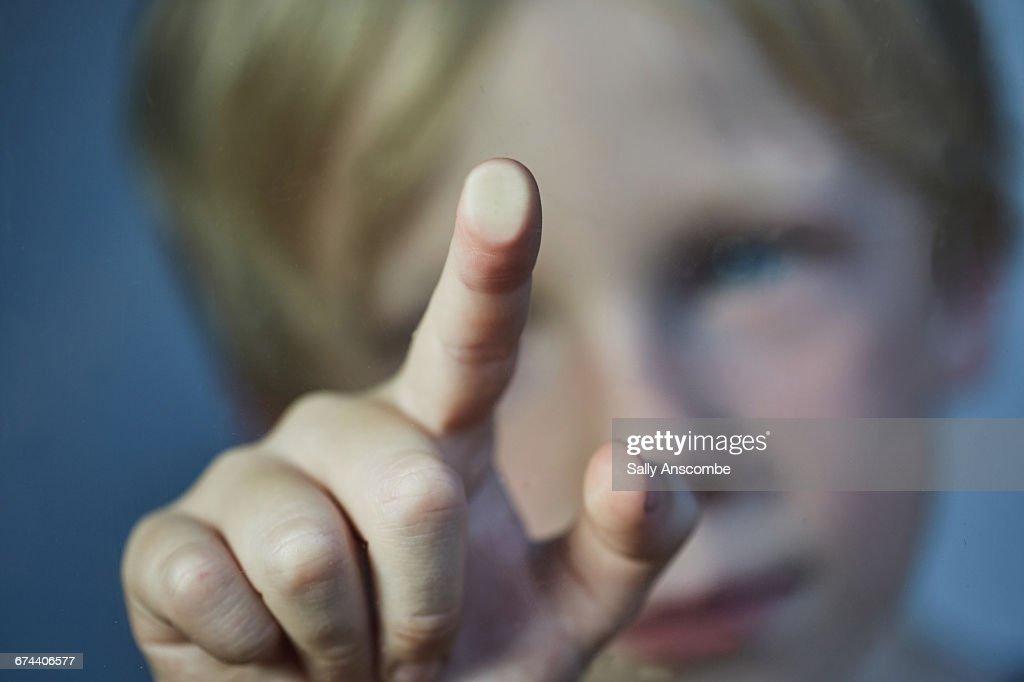 Child touching a screen : Stock Photo