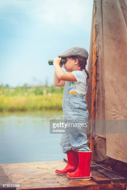 Kind Reisen auf Floß