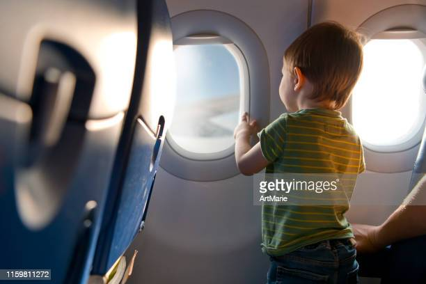 child travelling by plane - kid in airport stock pictures, royalty-free photos & images