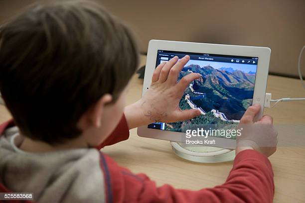 A child tries out the new Apple iPad 2 tablet at an Apple Store in Bethesda MD