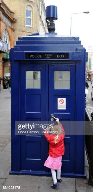 A child tries the door of a 'tardis' style police box outside Earl's Court tube station on Saturday January 5