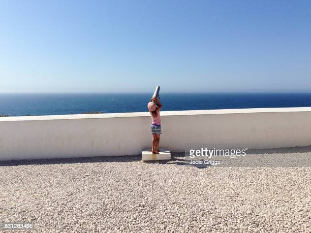 child trying to look through coin operated telescope while pointed at the sky - sagres stock pictures, royalty-free photos & images