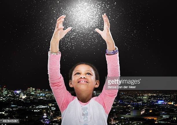 child trying to touch energy star ball. - paranormal stock pictures, royalty-free photos & images
