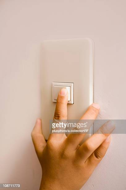 Child turning on a light switch