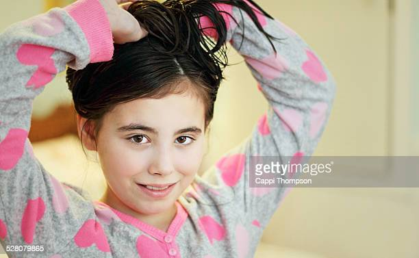 child tying her hair up - cappi thompson stock pictures, royalty-free photos & images